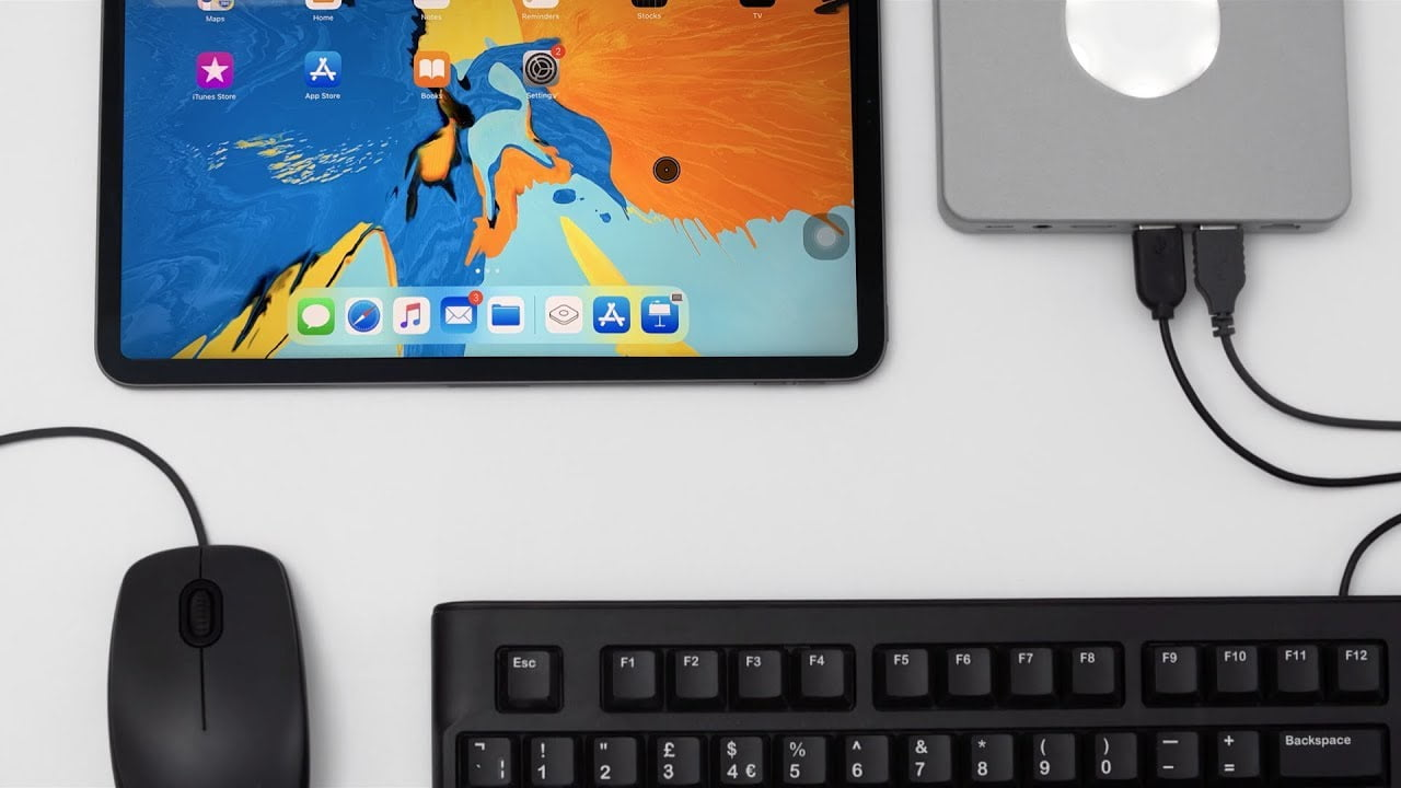 They get to operate an iPhone X with a Macintosh keyboard and mouse